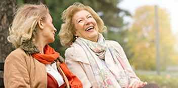 two women laughing