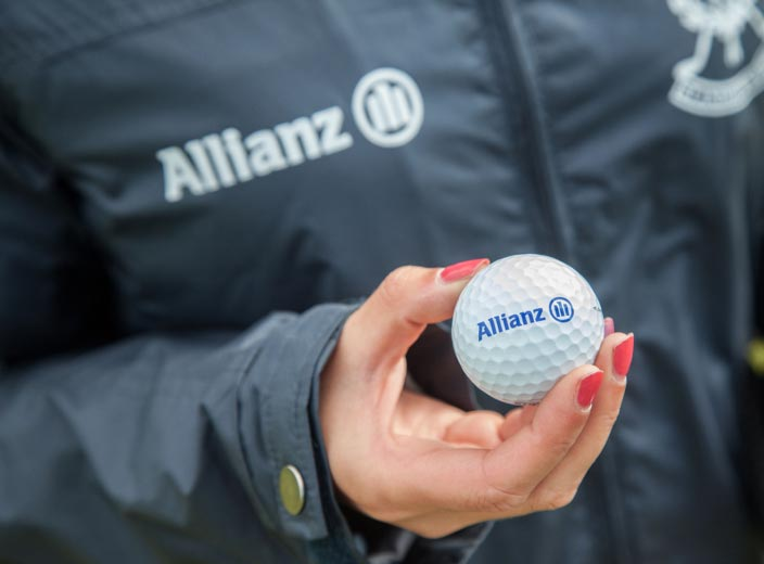 Individual holding golf ball