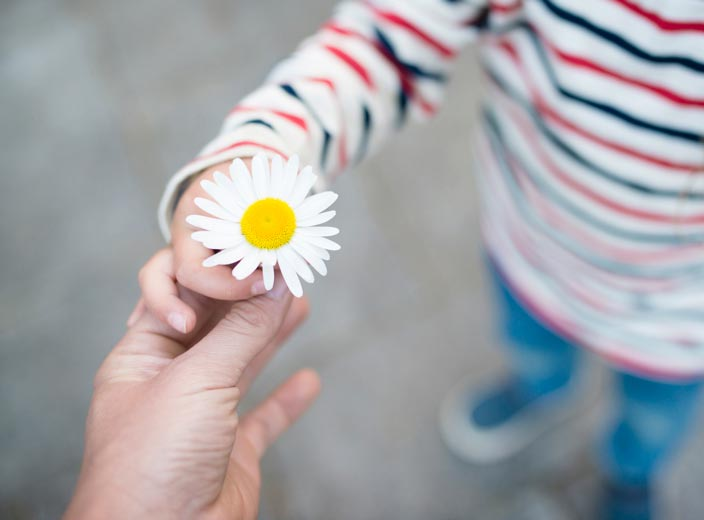 Person sharing flower